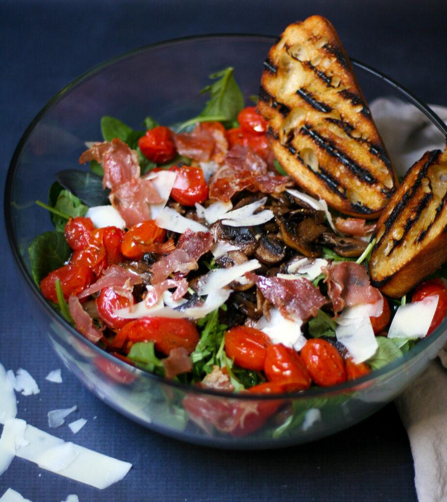Sautéed Mushroom Salad with Crispy Prosciutto, Blistered Tomatoes, and Gruyere