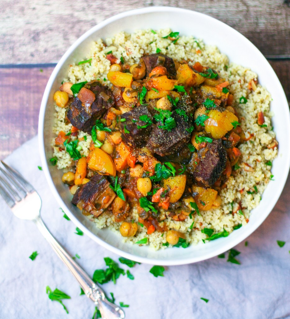 Beef and Apricot Tagine Over Couscous Closeup Overhead Shot in a Large White Bowl