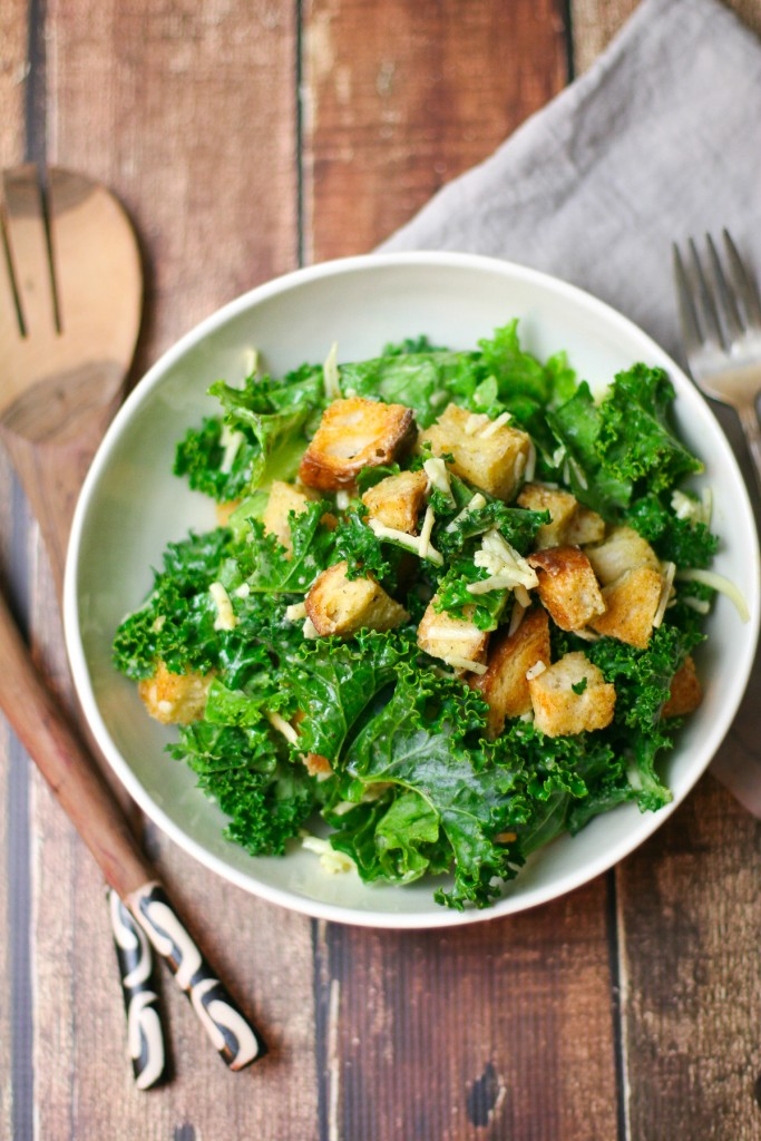 Kale Salad with Gruyere and Garlic Croutons Overhead Shot in Large White Bowl