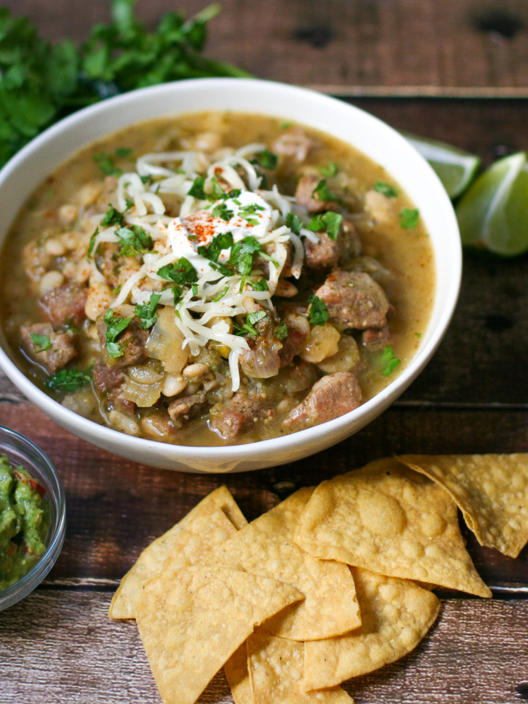 Giant Bowl of Pork Chile Verde Surrounded by Tortilla Chips