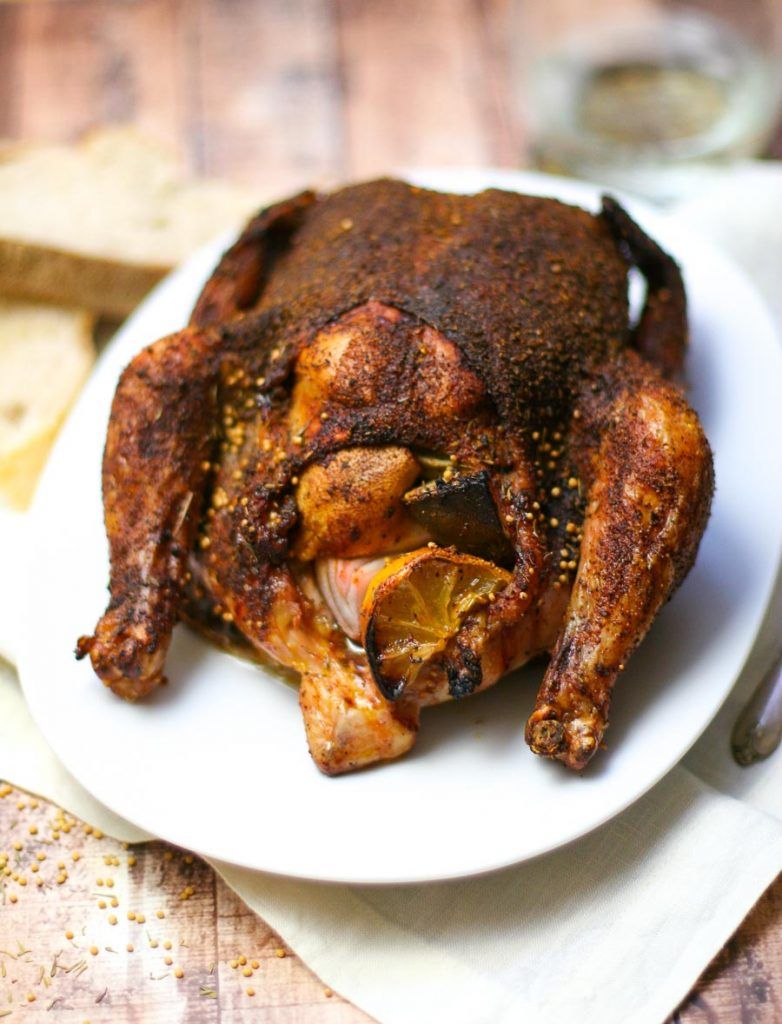 Spice Rub Roasted Chicken stuffed with lemon and shallot